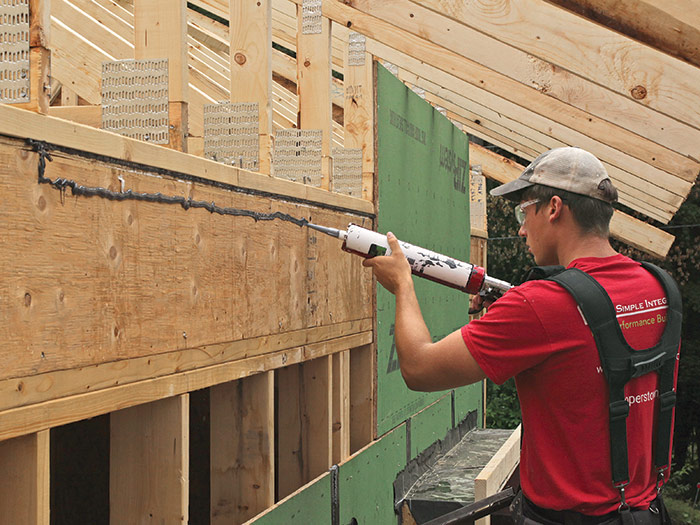 seal the sheathing to the rim with acoustical caulk