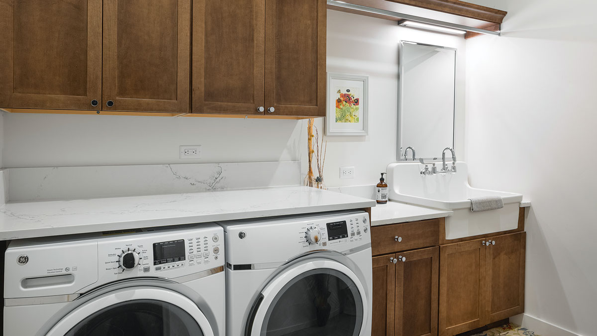 Space saver The laundry room is also a half-bath. This is unconventional but functions well and is efficient in terms of running plumbing lines. A hospital-style sink serves both toiletry and laundry purposes.