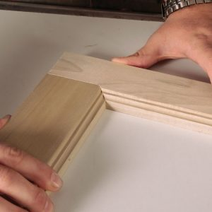 For the flat portion of the joint, use a tenoning jig to hold the stock vertically and square as it passes through the blade.