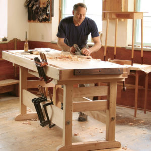 Plans for sturdy trestle base workbench for woodworking in hard maple with vise