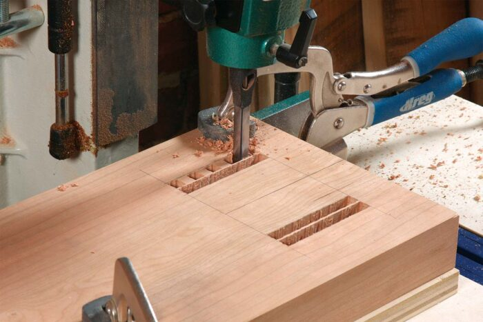 Outside rows first. Use a bit that's less than half the mortise's width.