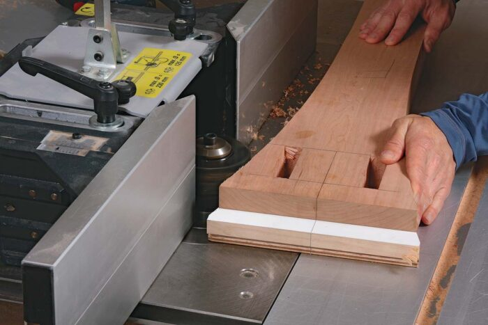 After roughing out the curves at the bandsaw, screw the post to a post template. Chaffin uses a shaper for the job, but a router table and a bearing-guided bit work, too.