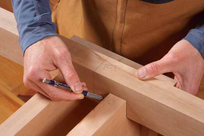 After dry-fitting the rails between the posts, set the brace in the notches, aligning its centerline with the post's.