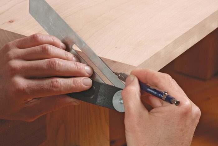 Bevel the table sides in two steps.Lay out the bevel. Set your bevel gauge to 60°. When you lay it on the angled end grain, it creates a bevel that's 64° to the top.