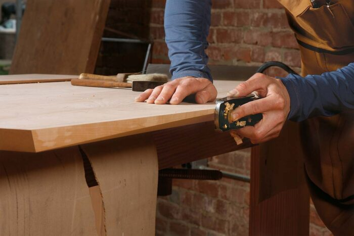 Clean up the sawn edge with a block plane