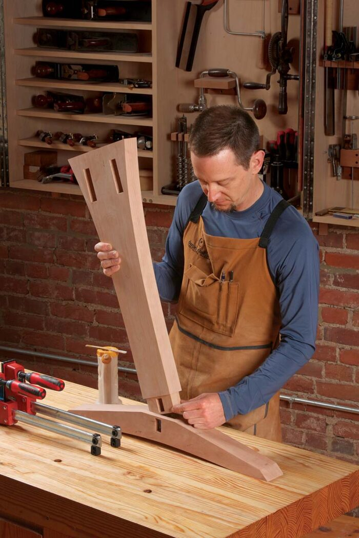 Brush it on all four walls of the mortise instead. After inserting the post, check the stretcher mortise for glue. Do both posts, and let them dry.