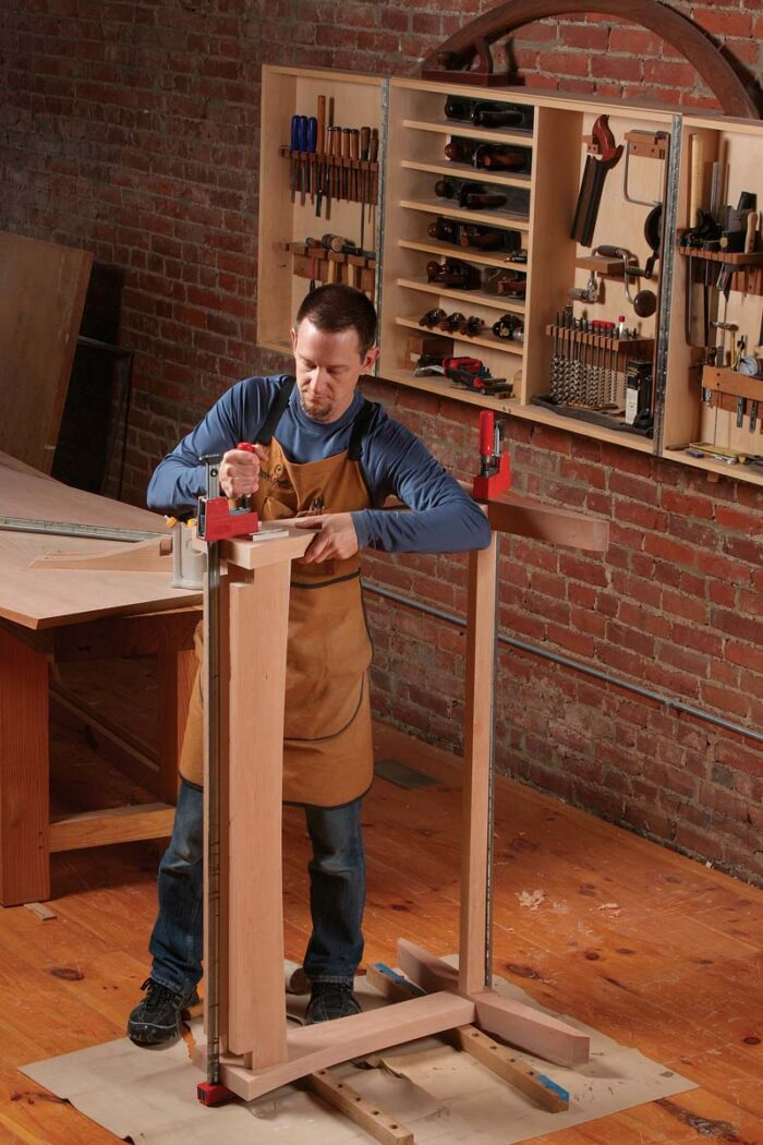 Add the rails and stretcher. Raise the bottom post off the floor to create clearance for clamps.