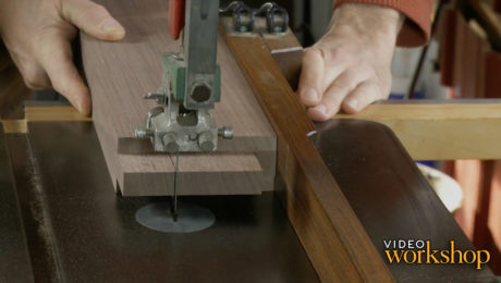 overlapping mortise-and-tenon joinery that secures the table's vertical column elements to their mating feet and arms