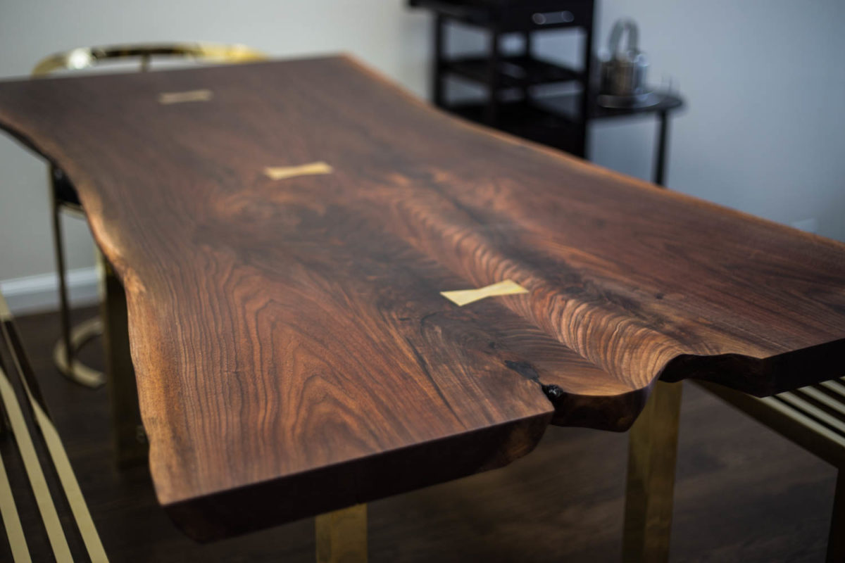 Black Walnut Dining Table With Brass Bowties And Base