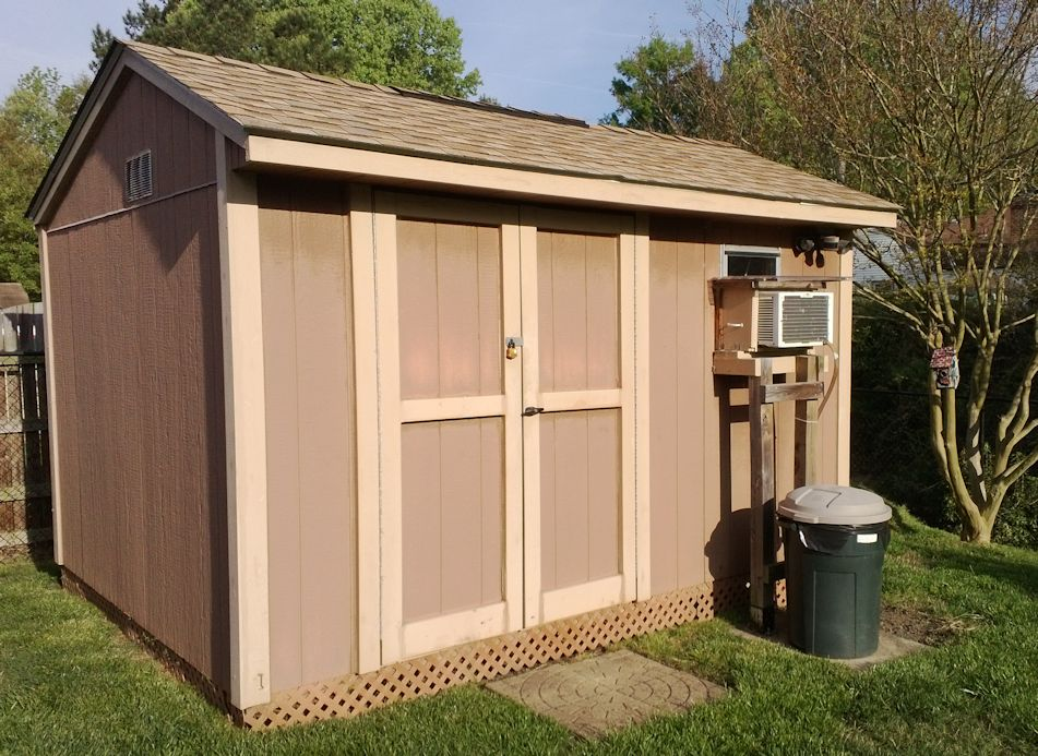 the little brown garden shed home of the tri color turners
