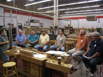 The Class- Bob Van Dyke (left), Director of CVSW welcomes the class, provides an overview of whats ahead and goes over some shop best practices and ground rules.  A sample of the workbench we are to build is in the foreground.  We are not doing the cabinet shown below.
