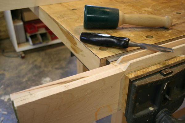 putting miters on the interior corners of a frame and panel door by hand; miters with a chisel