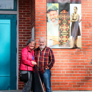 Abraham and his wife, Carmen, outside the Wood Works show.
