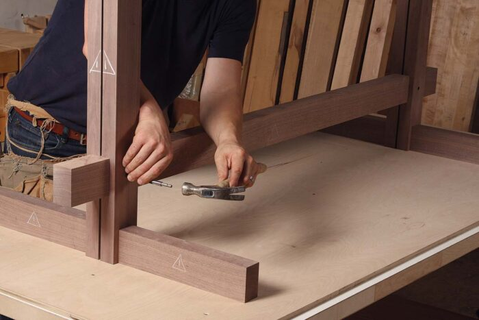 ry-fit the feet, stretcher, and posts, and use a brad-point bit to mark the peg location in the stretcher
