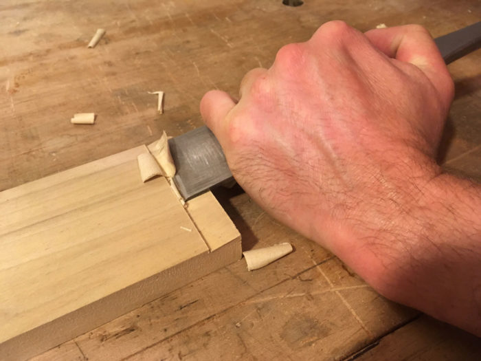 With one hand down near the cutting edge, I anchor the tool and pivot it on the reference surface, while my other hand back on the handle powers the tool forward with a slicing motion