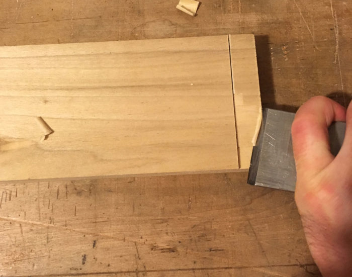 I then slide the chisel down the length of the tail another 1/2 in. or so, register the rest of the tool's back against the accurate cut I've just made, and allow that to guide the next cut