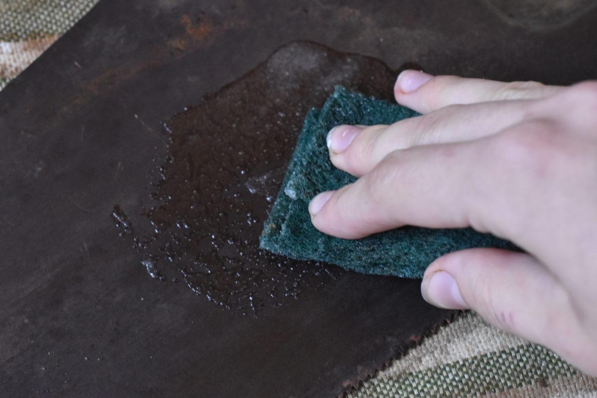 scrubbing rust off of saw