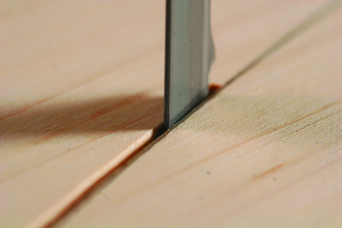 pivot off of the back of the bandsaw blade