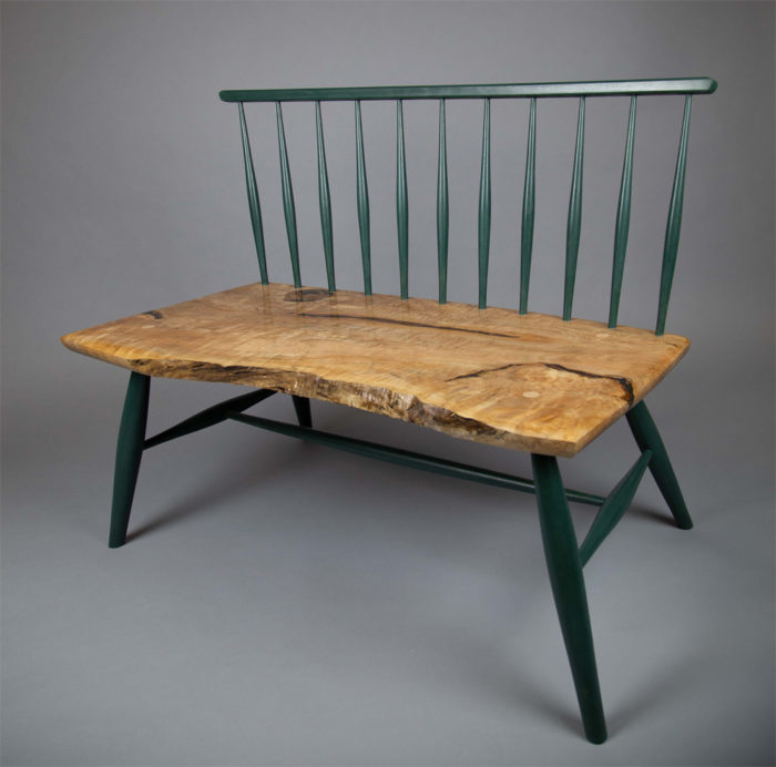 wooden bench with green accents