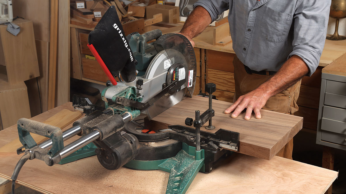 Big cuts are no problem. For square and plumb cuts, this miter saw can handle boards 4 in. thick by 14 in. wide.