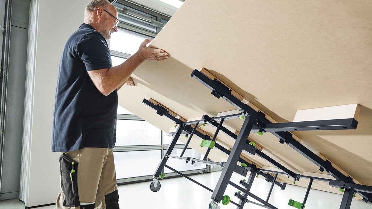 The table securely supports sheet goods up to 10 ft. by 7 ft., and it doubles as an assembly bench. It pairs with Festool's portable track saws and guide rails to create a mobile panel saw station.