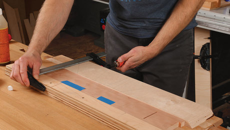 Wide plywood cauls even out clamping pressure.