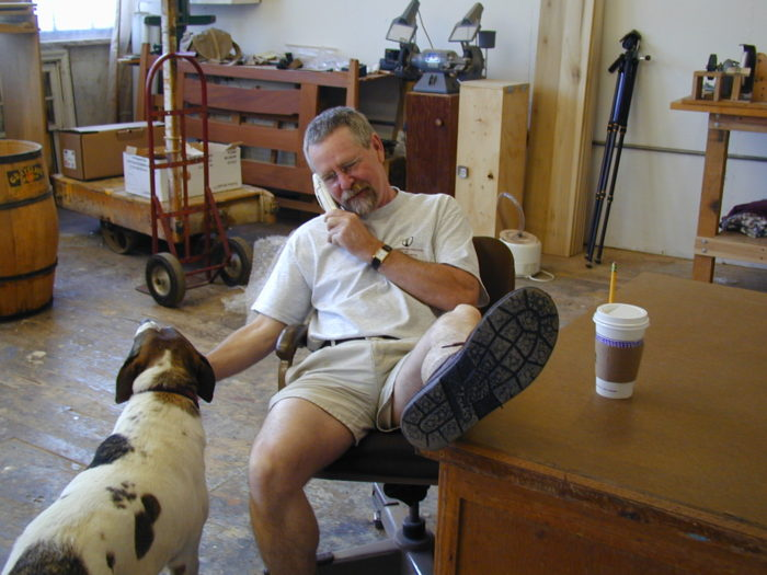 Phil Lowe sitting down petting a dog