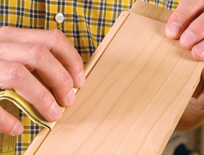 Contouring sand paper to fit curves when hand sanding