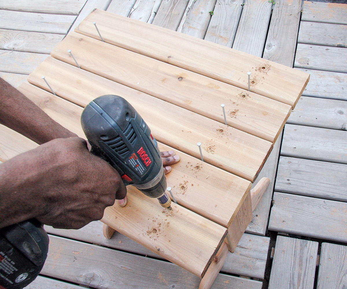 Lay the top slats on the horizontal supports