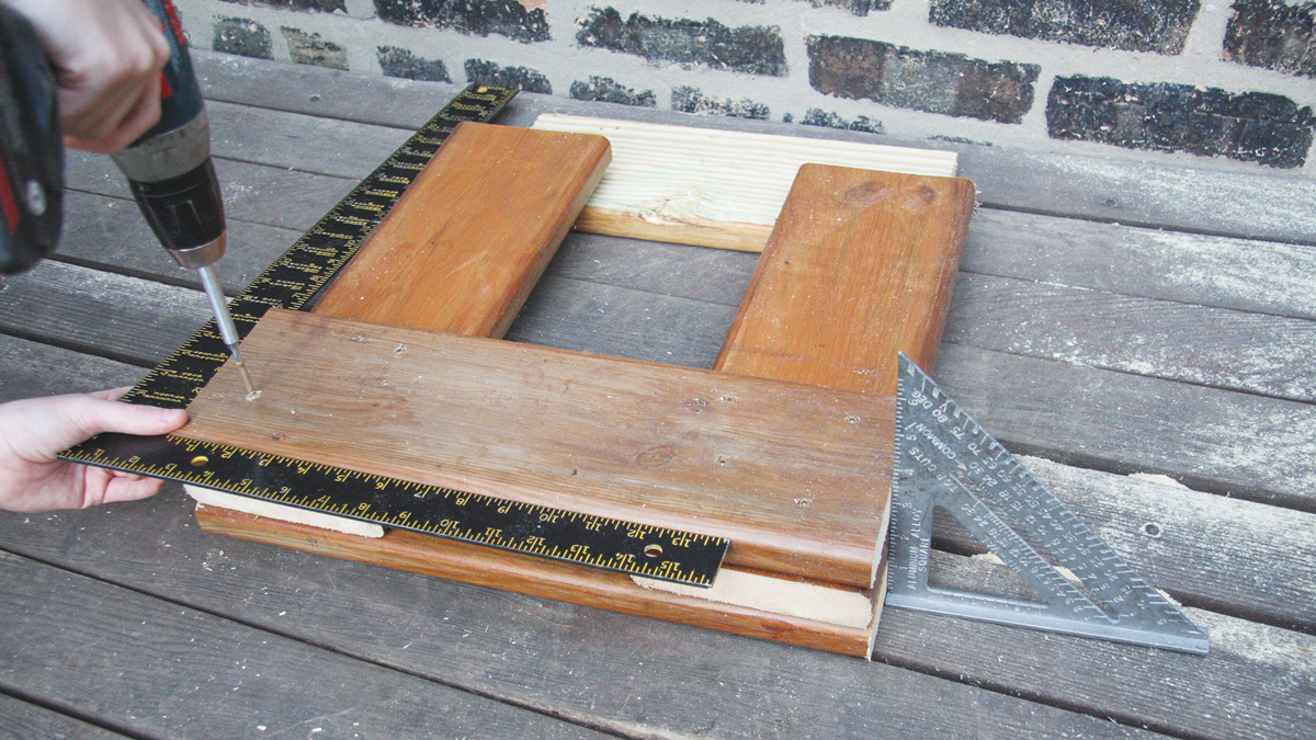 Use a square to keep things aligned, and a scrap piece to hold the legs up, as you build each of the six supports.