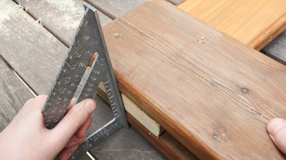 Use an angle square (inset) to make sure the tops of the horizontals are even with each other.