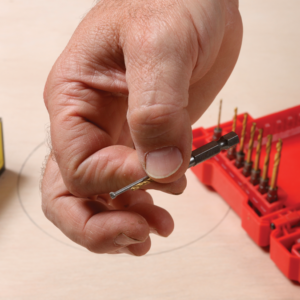 The circle-cutting jig will pivot on a nail, so find a nail and drill bit that match each other.
