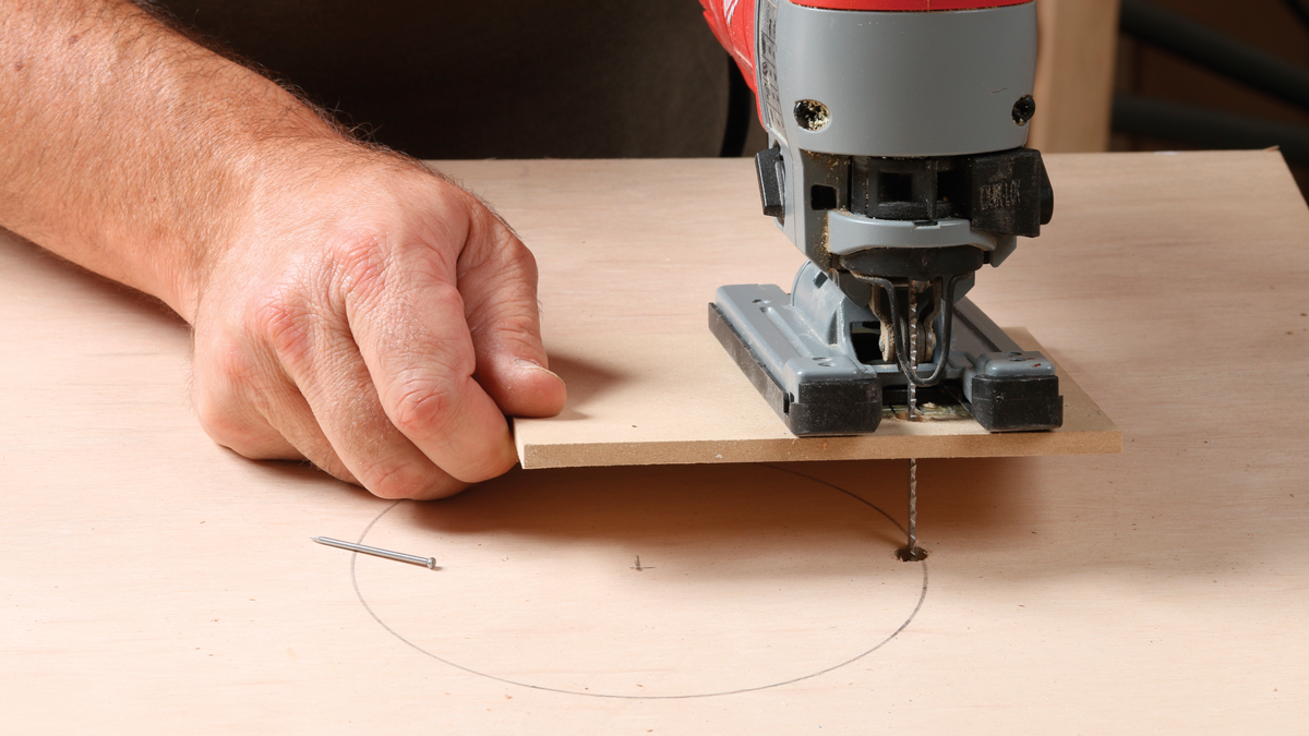Drop the blade into the hole, press the pivot nail down, and start cutting!