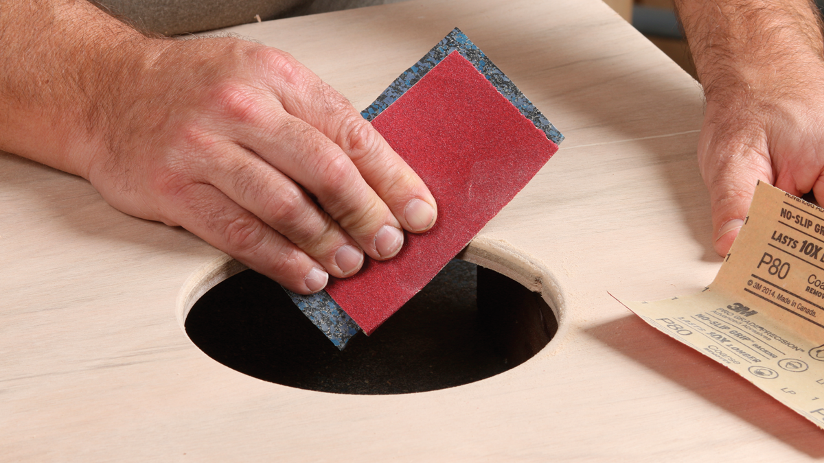 Sand it smooth. Use rough sandpaper to bevel the edge of the circle.