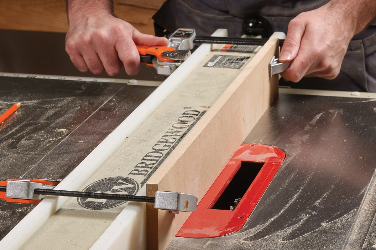 Clamp the auxiliary fence to the tablesaw's rip fence