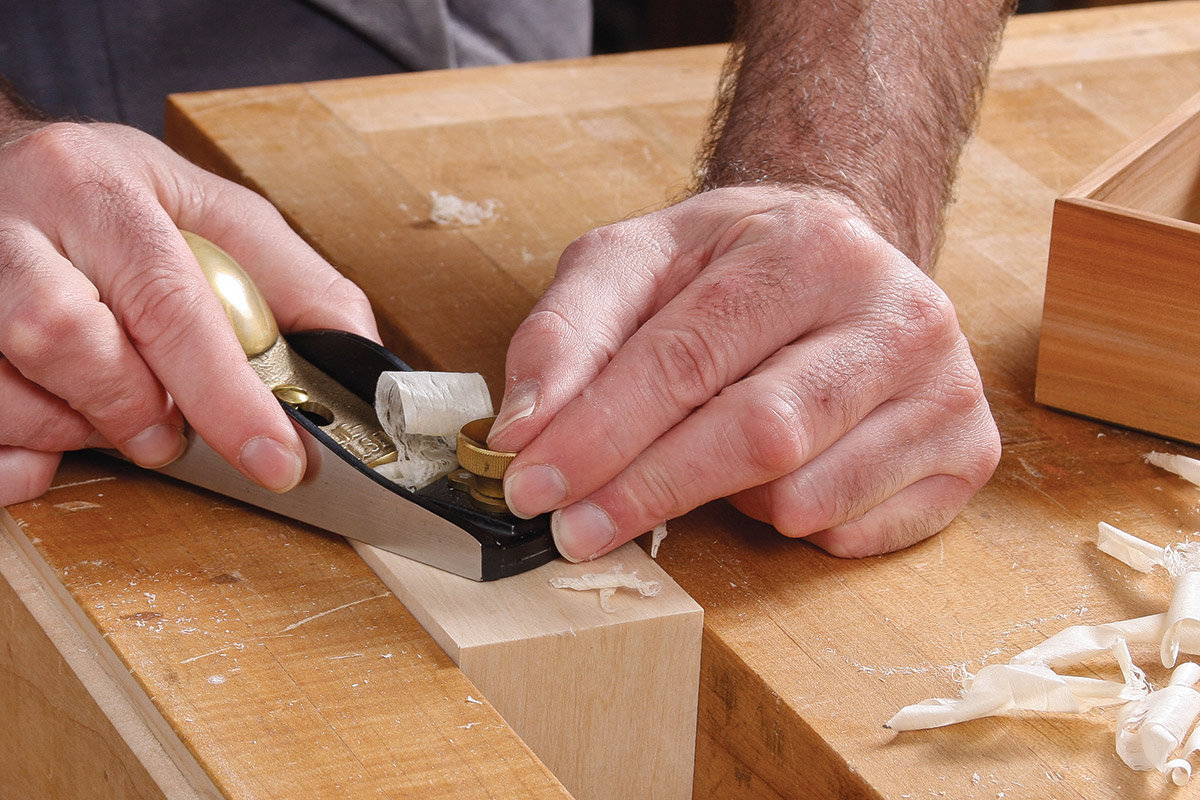 Plane the sides to fit into the lid box