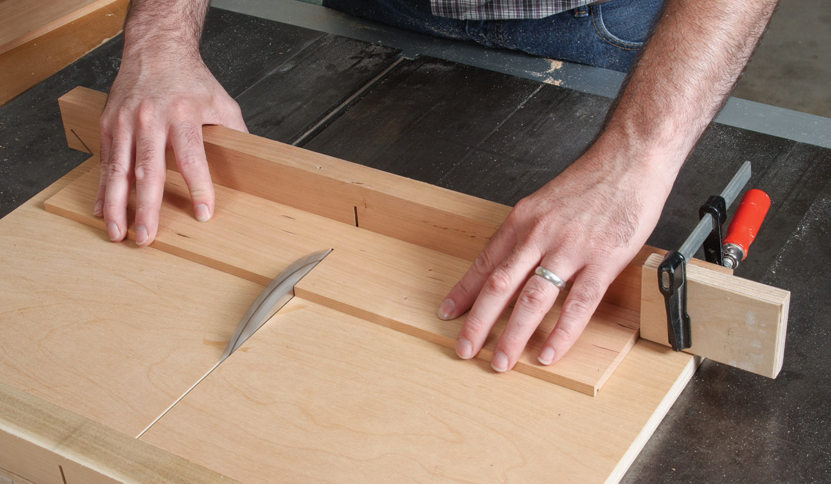 With a stop block clamped to the crosscut sled, cut the box sides to length