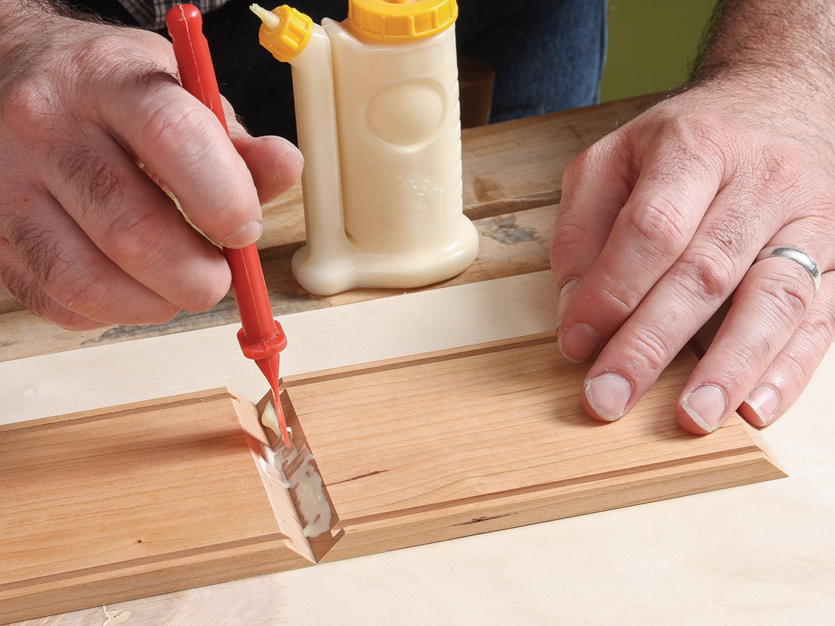 Carefully spread glue over the miter joints, except the open ends