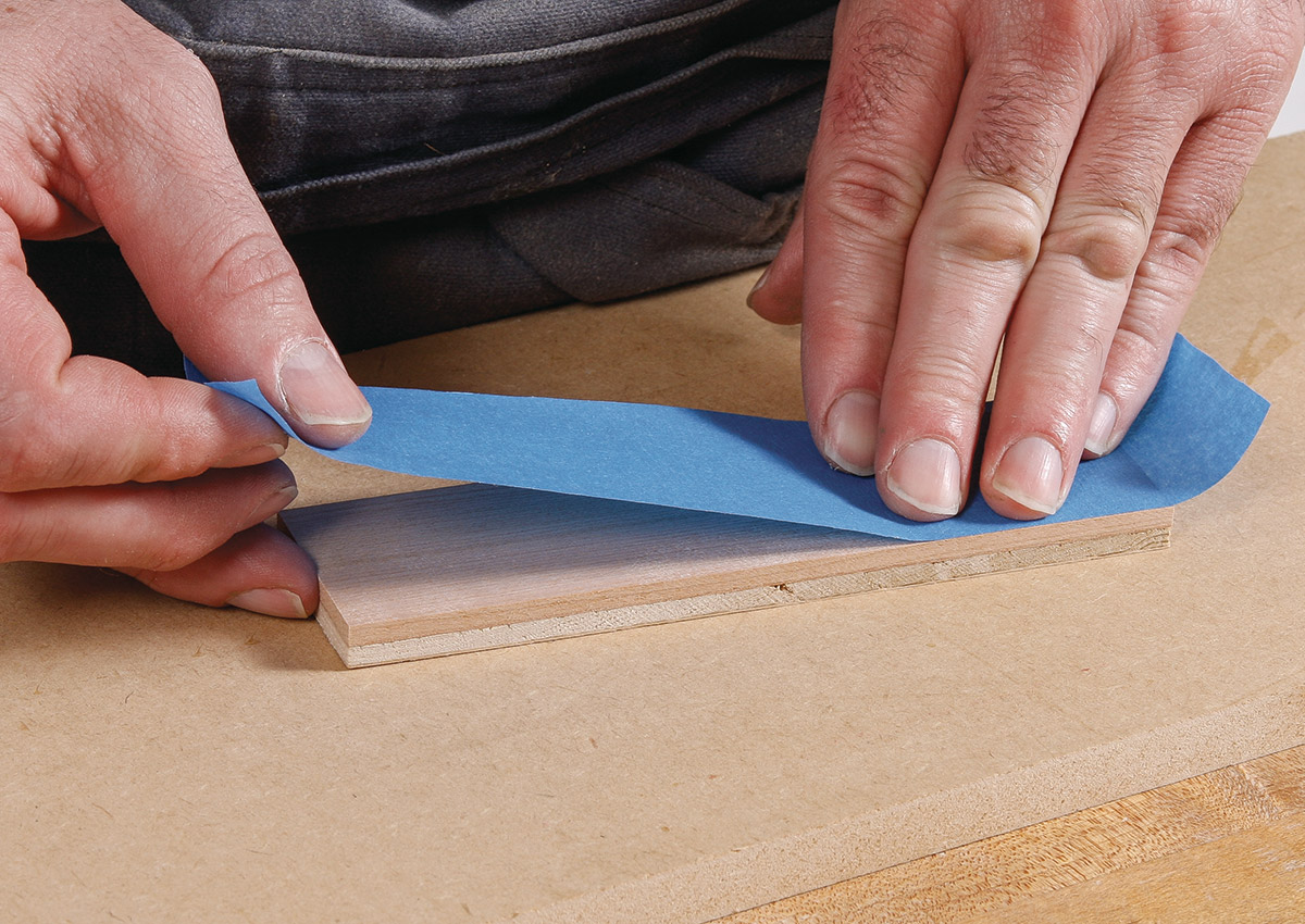 Completely cover the veneer face with blue painter's tape