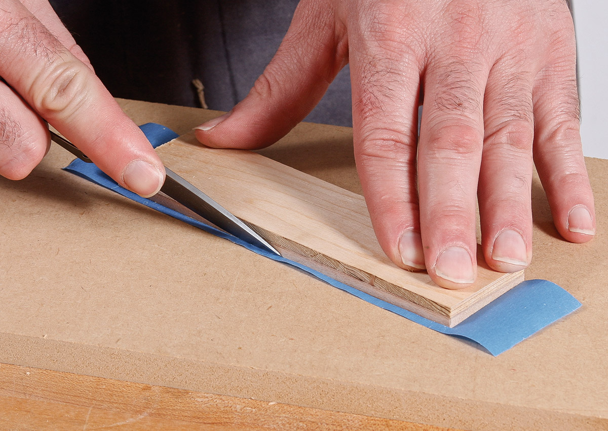 Trim the tape flush with the edges of the bottom