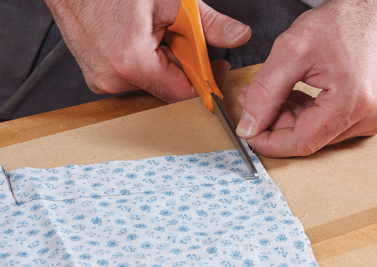 Cut the fabric just inside the pen line