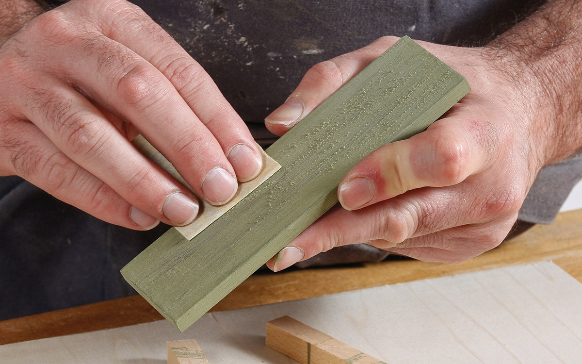 Apply a second coat, let dry, and then sand with 320-grit paper