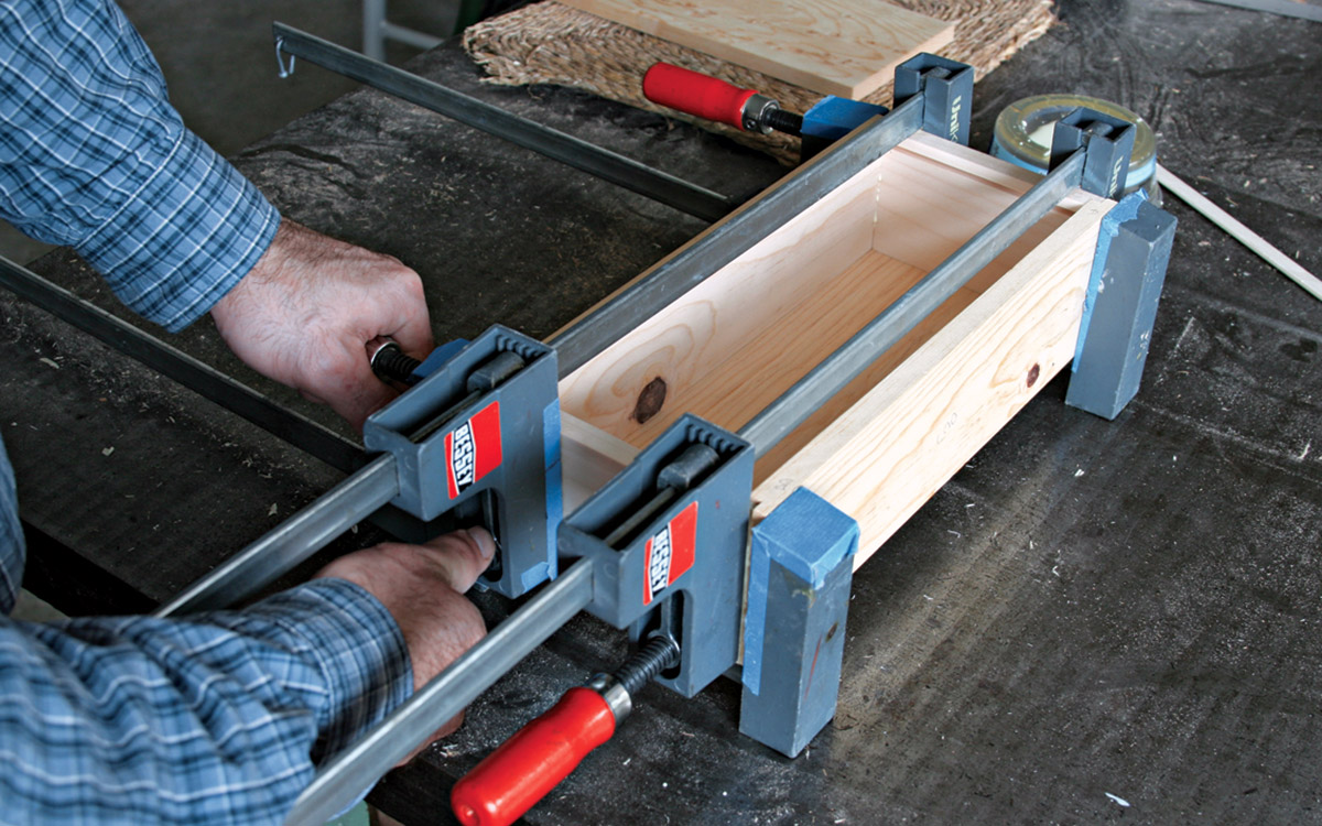 Apply clamps across the length and the width of the box