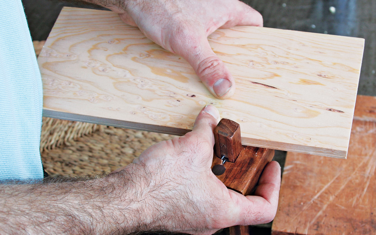With a marking gauge, scribe a line