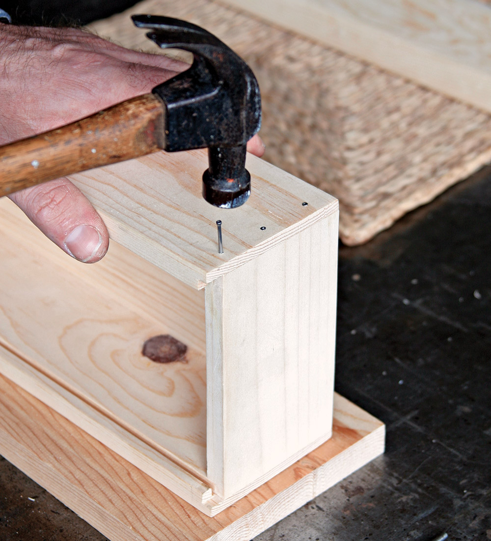 Hammer the nails into the rabbet flush with the surface