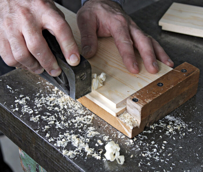 Trim the piece with a shoulder plane secured in place with a bench hook.
