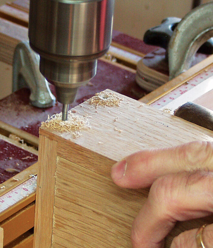 Drilling the corners of the box to accept dowels