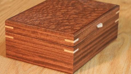 A finished veneered box