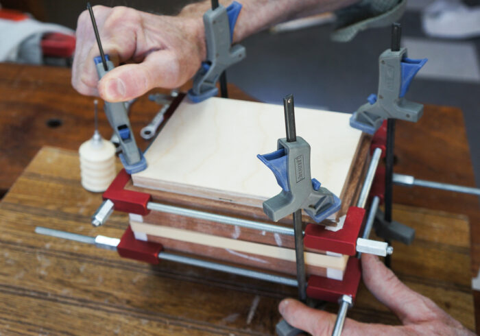 Using a block of wood to distribute clamping pressure