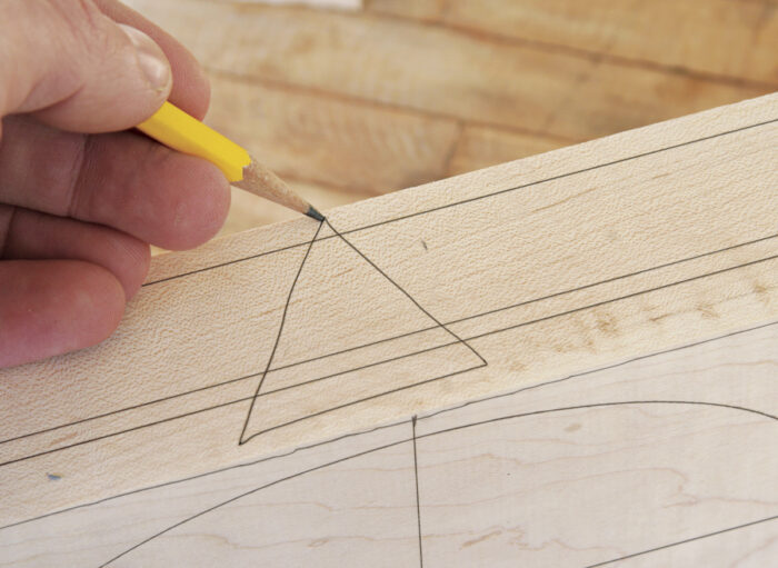 Make a triangle on the edge of the box as a guide to reassemble the box after it has been sawn apart.